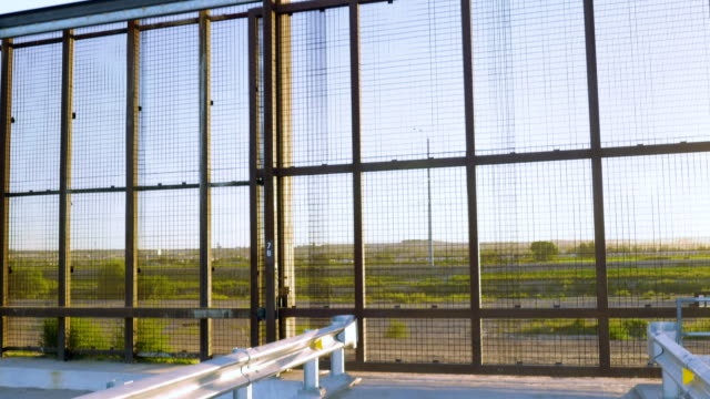 Tilt Up to Reveal the Border fence Between Mexico and America - 4K video