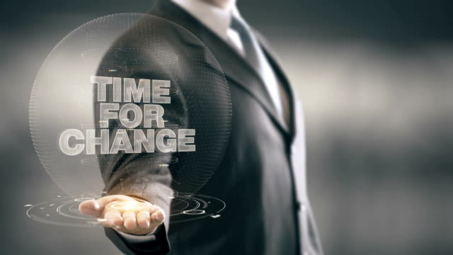 Time for Change Businessman Holding in Hand New technologies video