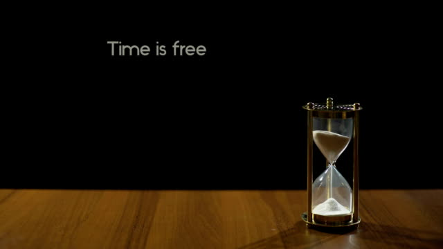 Time free but priceless, wise expression about value of life, sandglass on table video