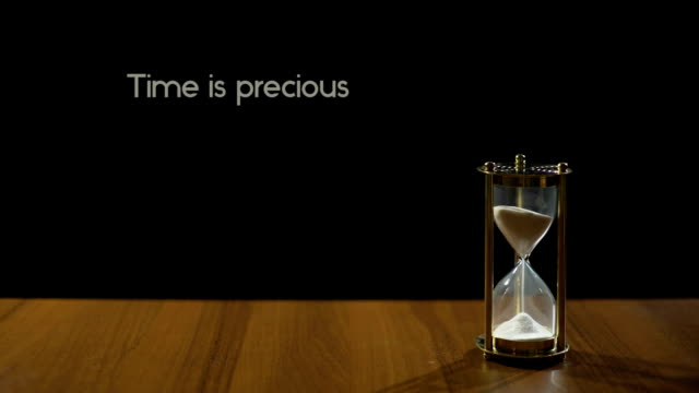 Time is precious, popular expression about value of life, sandglass on table video
