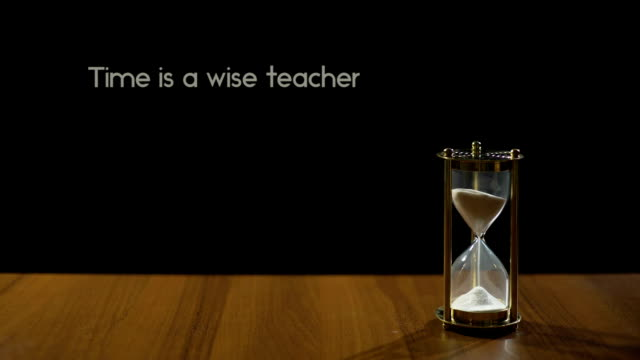 Time is wise teacher, popular expression about experience, hourglass on table video