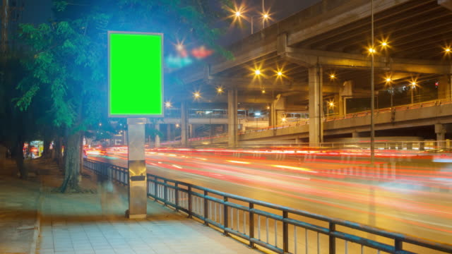 4K Time Lapse 4096x2160 : The traffic motion and green billboard with ProRes 422HQ (Blur content). video