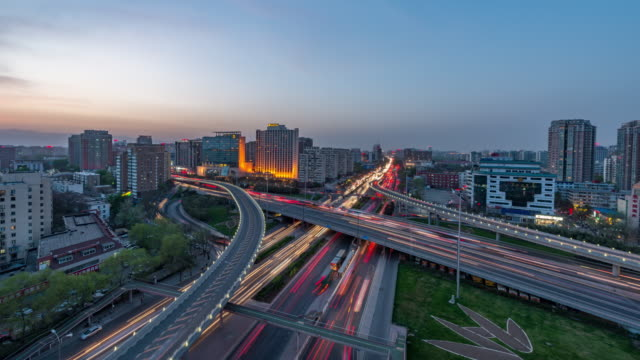 Time Lapse- Aerial View of Beijing Road Intersection, Day to Night Transition (WS RL Pan) video