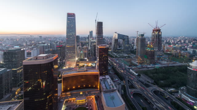 Time Lapse - Aerial View of Beijing Skyline, Day to Night Transition (WS) video