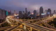 Time Lapse- Aerial View of Busy Overpass at Dawn, from Night to Night (Zoom) video