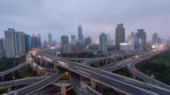Time Lapse- Aerial View of Busy Overpass in Shanghai, Day to Night Transition (WS HA) video
