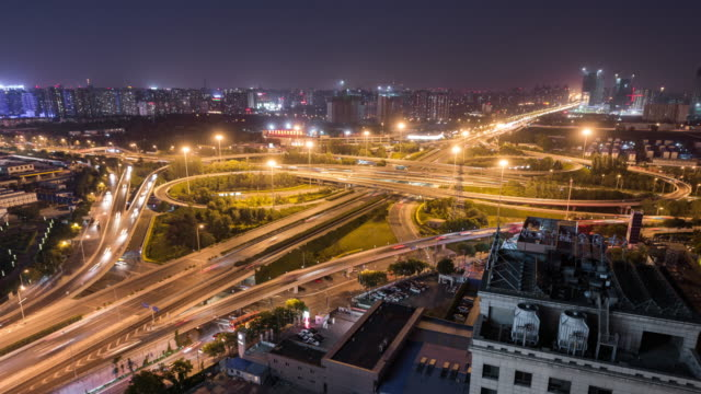 Time Lapse - Aerial View of Road Intersection at Night (WS) video