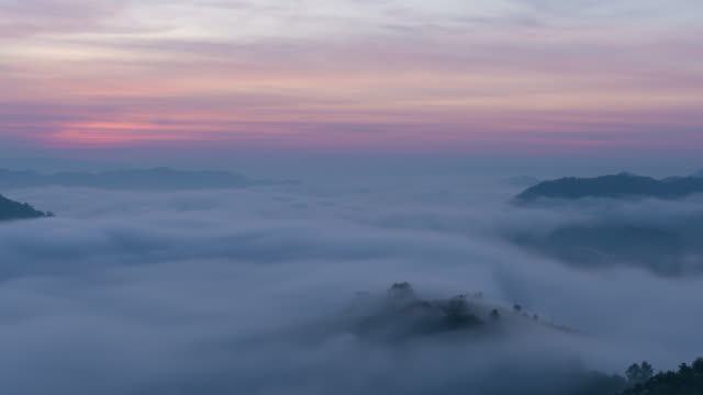 Time lapse amazing nature mist moving over the nature mountains during sunrise in morning time video