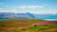 Time Lapse - Ariel View Lake Tekapo with Mountain Range and Beautiful Clouds video