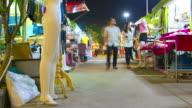 time lapse : Asian people enjoy shopping at retail market night scene video