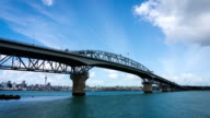 Time Lapse Auckland Harbour Bridge Reflecting on Westhaven Marina in Auckland video
