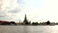 Time lapse beautiful cloud The Temple of Dawn, Wat Arun, on the Chao Phraya river and a beautiful blue sky in Bangkok, Thailand. Horizontal with copy space video