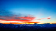 Time Lapse - Beautiful Orange Clouds at Sunset Over the Valley video