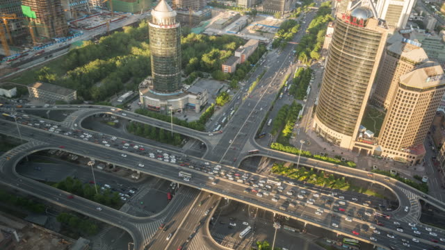 Time Lapse- Beijing, Aerial View of Busy Road Intersection (WS HA Panning) video