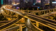 Time Lapse- Busy Road Intersection in Shanghai at Dawn, from Night to Day (Zoom) video
