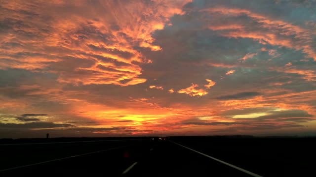 time lapse car driving at dramatic sunset video