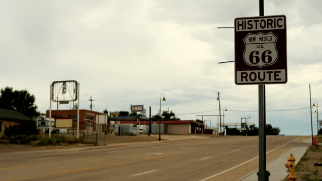 4K Time Lapse cars drive by Historic Route 66 road sign Santa Rosa, New Mexico video
