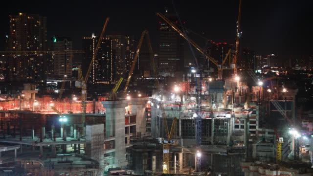 4K Time lapse crane and building under construction video