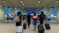 Time Lapse : Crowd of travellers in Hong Kong international airport terminal video