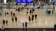 Time Lapse : Crowd of travellers in the airport terminal at Hong Kong international airport video