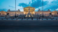 Time Lapse, Crowd waking at Austrian Parliament Building at dusk video
