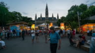Time Lapse, Crowd waking Rathaus at dusk, Vienna video