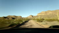 time lapse dusty gravel road desert video