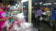 Time lapse Flower Market (Pak Khlong Talat) in Bangkok. Flower merchants and traders are selling and buyers shopping more.  It is the biggest wholesale and retail fresh flower market in Bangkok Thailand video
