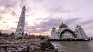 time lapse footage of a  sunrise at Melaka Strait Mosque video