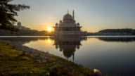 Time lapse HD Footage of Sunrise At Putra Mosque, Putrajaya During Partial Eclipse. Showing a rising and sunburst video