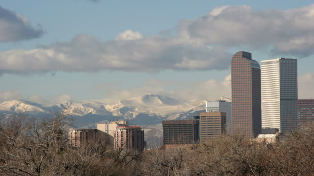 Time lapse HD Video clouds over Denver and mountains video