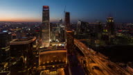 Time Lapse- High angle view of Beijing Skyline at Dawn, from Night to Dawn (WS HA Zoom out) video