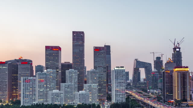 Time Lapse- High angle view of Beijing Skyline, Day to Night Transition (Panning) video