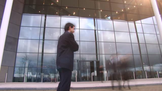 Time lapse large business entrance video