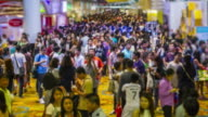 time lapse : large number of people travelling at indoor event video