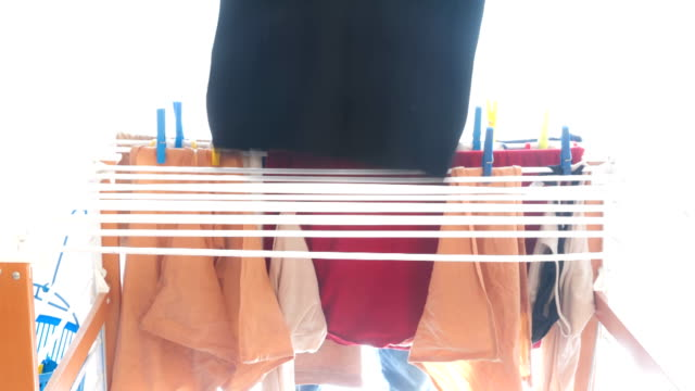 Time lapse - Man in action at drying rack video