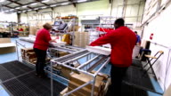 Time lapse manufacturing staff in production factory business video