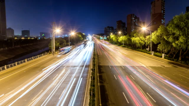 Time lapse night motion light trails on a busy freeway video
