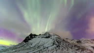 HD Time Lapse : Northern Lights over mountains video