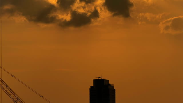 Time lapse of a construction site in silhouette video