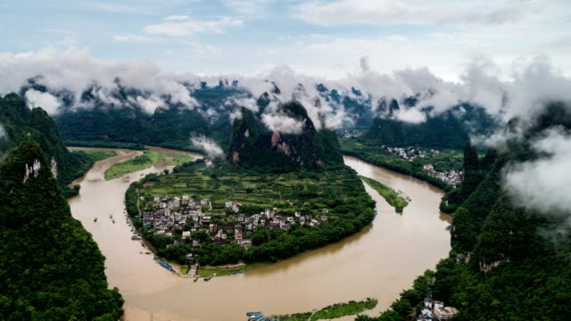 time lapse of aerial view of Li River and Karst mountains. Located near The Ancient Town of Xingping, Yangshuo County, Guilin City, Guangxi Province, China. video
