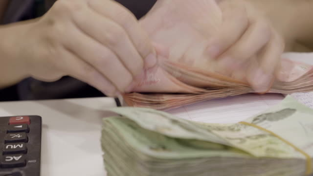 Time Lapse Of Asian Women Counting Money Thai Baht On Her Workplace In Home video