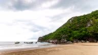 Time Lapse of Beautiful Sand Beach and People Activity with Cloudy Sky. Crane up shot. video
