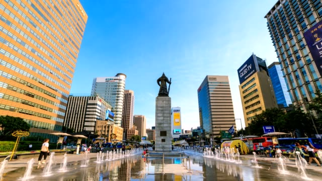 4K Time lapse of beautifully color water fountain and office building at Gwanghwamun Plaza with the statue of the Admiral Yi Sun-sin in downtown Seoul,South Korea. video