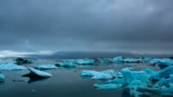 Time Lapse of blue icebergs floating video