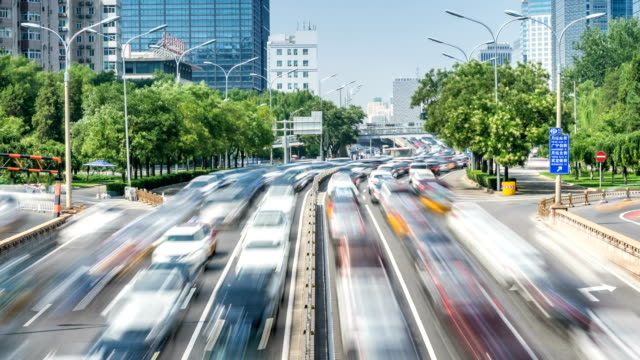 Time lapse of busy traffic and modern buildings in Beijing city , China. video