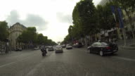 Time lapse of car driving trough Champ Elysees in Paris video