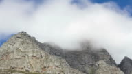 Time lapse of clouds moving over top of Table Mountain in Cape Town, South Africa. Shot from behind Table Mountain, iconic mountain top not visible video