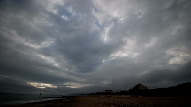 Time lapse of clouds over a deserted beach video