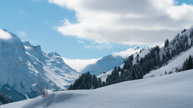Time lapse of clouds over an alpine valley in Warth, Austria video